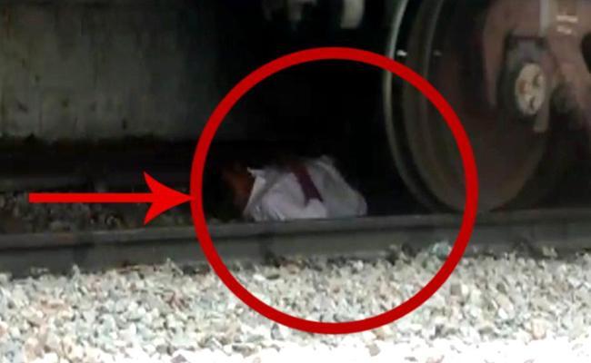 Man Sleeps Between Railway Track in Ananthapuram - Sakshi