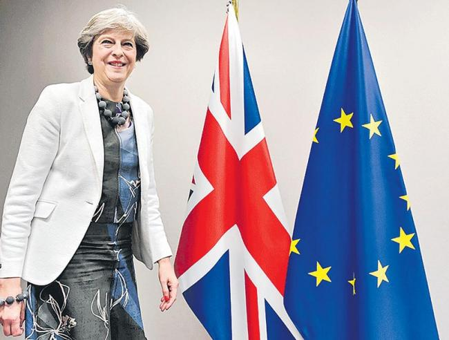 Theresa May to visit Brussels this week as she defends Brexit deal - Sakshi