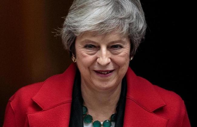 Theresa May fires warning to rebel MPs - Sakshi