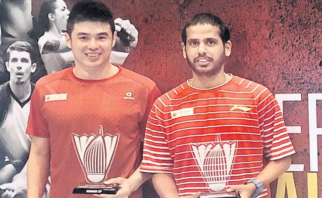 Tarun Pair settle as Runnerup in Dubai Badminton - Sakshi