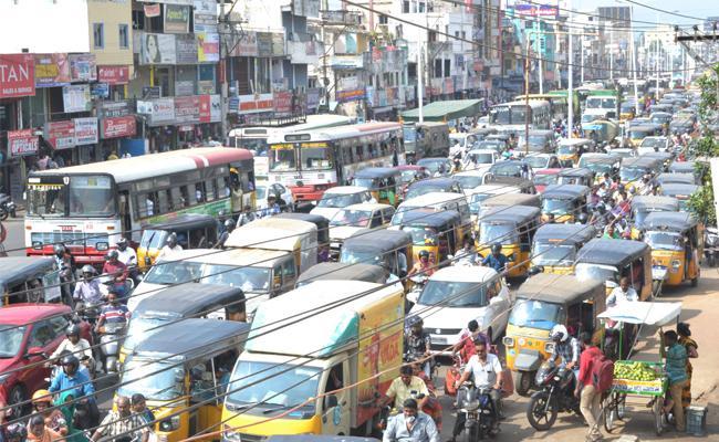 NAD Junction Traffic Jam in Visakhapatnam - Sakshi