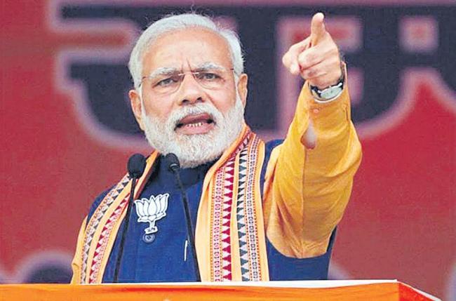 PM Modi slams Congress while addressing BJP workers - Sakshi