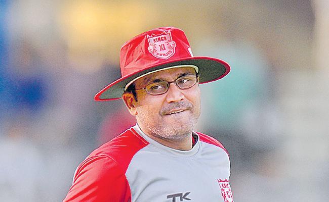 Virender Sehwag ends his association with Kings XI Punjab - Sakshi