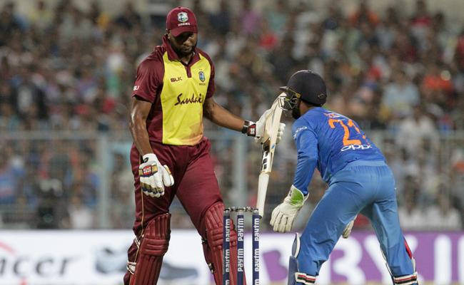 Karthik become second wicket keeper in t20s Most Catches List - Sakshi