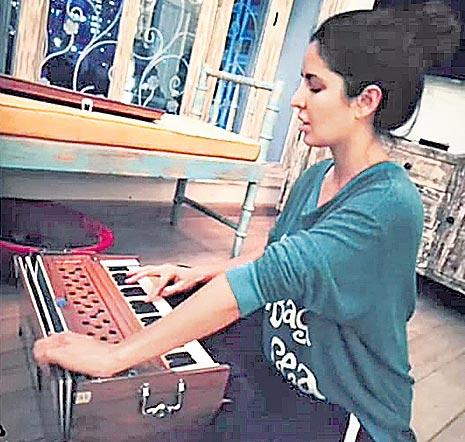 Katrina Kaif spotted playing harmonium - Sakshi