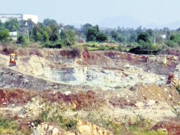 TDP Leader illegal mines reopened - Sakshi