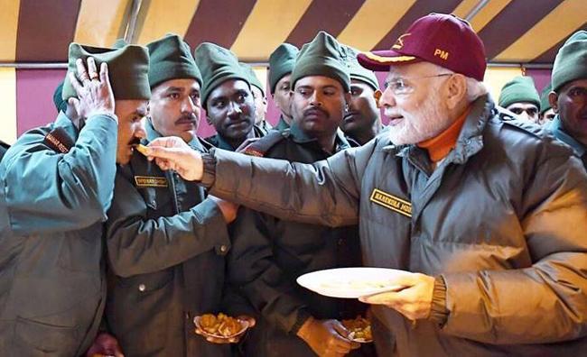 Modi celebrates Diwali with Jawans - Sakshi
