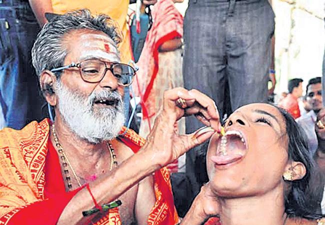 Asthma patients can swallow this fish prasadam - Sakshi