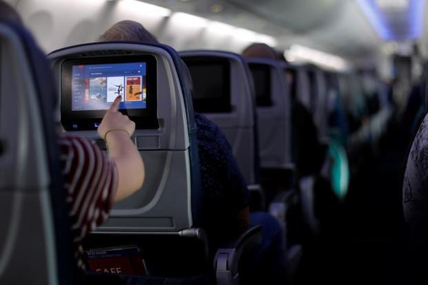 Government notifies rules for in-flight calls, internet access - Sakshi