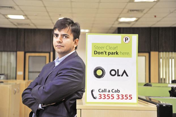 Ola invests  usd 100 million in scooter-sharing startup Vogo - Sakshi