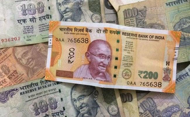 Rupee logs best day in over 5 years, vaults 112 paise on crude slide - Sakshi