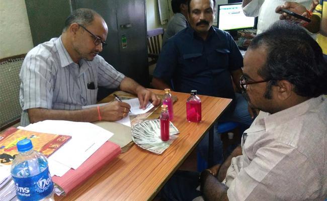 VRO Caught Demanding Bribery in West Godavari - Sakshi
