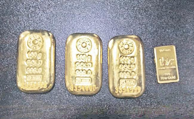 Gold Biscuits Caught From Woman In Shamshabad Airport - Sakshi