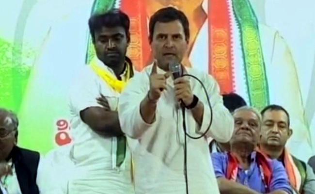TRS Remote In Modi Hand Say Rahul Gandi - Sakshi