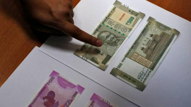 Rupee could slip to 75 against dollar by end-2019 on widening CAD: Fitch - Sakshi