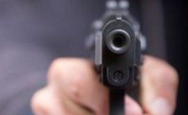 TDP Leader Aimed Revolver On Young Man - Sakshi