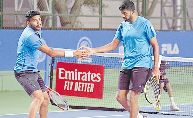 Divij -Bopanna pair enter to quarter final - Sakshi