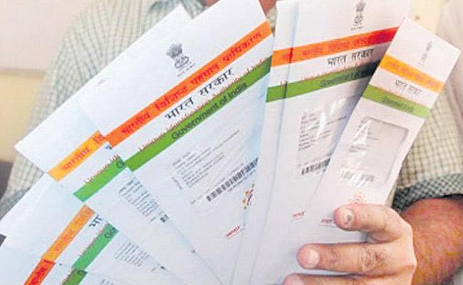 1 Crore Fine For Failing To Comply With Aadhar Act Norms - Sakshi