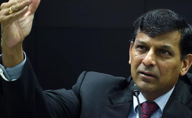 Best Minister Should Handle HRD Portfolio Says Raghuram Rajan - Sakshi
