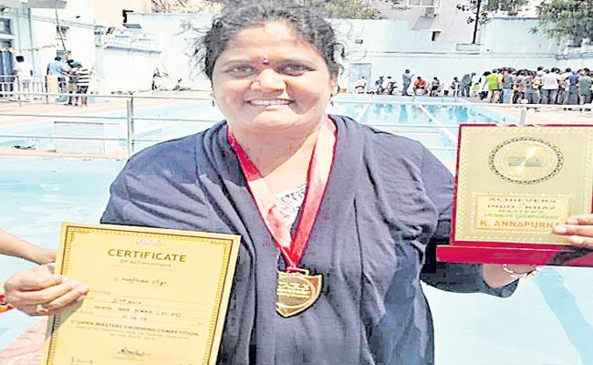 She took her to international level in swimming - Sakshi