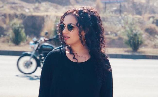 Nithya Menon Highway Shoot Pic Goes Viral - Sakshi