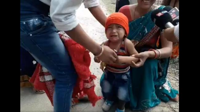 Assam Toddler Forced to Remove Black Jacket Before Entering Into CM Rally - Sakshi