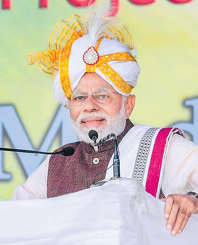Narendra Modi assures no Indian citizen will be excluded from NRC - Sakshi