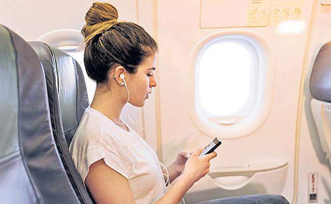 Govt to form inter ministerial panel to roll  in flight mobile services - Sakshi