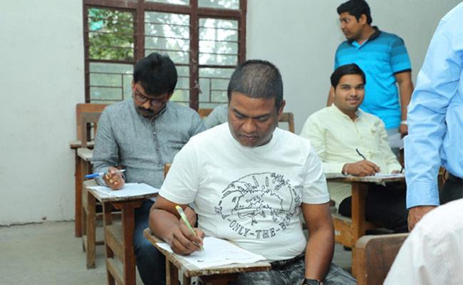 TRS MLA Jeevan Reddy Writes LLM Exames - Sakshi