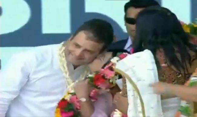 A woman kisses Congress President Rahul Gandhi in Gujarat - Sakshi