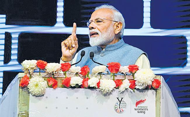 Focus on middle class houses - modi - Sakshi