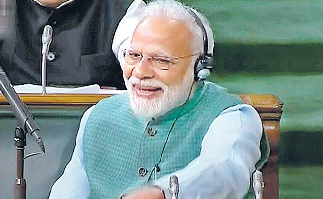 PM Modi Says Poverty Reducing Significantly Through Govt Schemes  - Sakshi