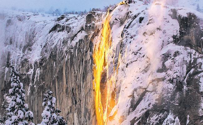 Sunlight makes this waterfall look like lava - Sakshi