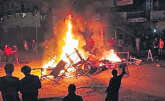 The protest rally turned violent on Sunday - Sakshi