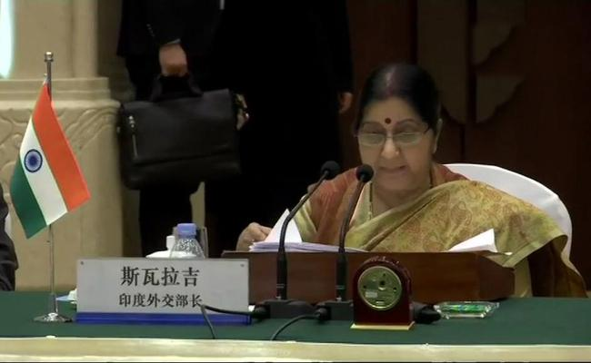EAM Sushma Swaraj Meets Chinese Foreign Minister Wang Yi  RAussian Foreign Minister Sergey Lavrov - Sakshi