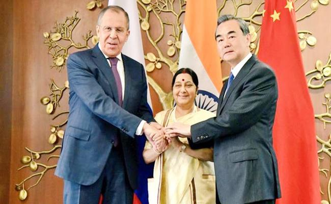 Sushma Swaraj Comments In RIC Meet In Beijing - Sakshi