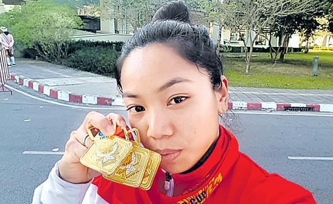 Indian weightlifter Mirabai Chanu won gold  - Sakshi