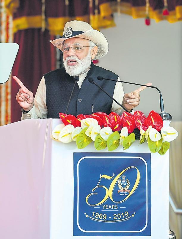 PM Modi attends 50th CISF's Raising Day ceremony - Sakshi