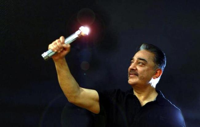 Kamal Haasan's MNM gets battery torch as party symbol - Sakshi