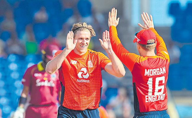 England thrash West Indies in third T20 international - Sakshi