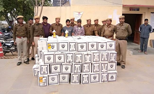 Police Have Seized Liquor Bottles From A Truck During A Vehicle Checking In - Sakshi