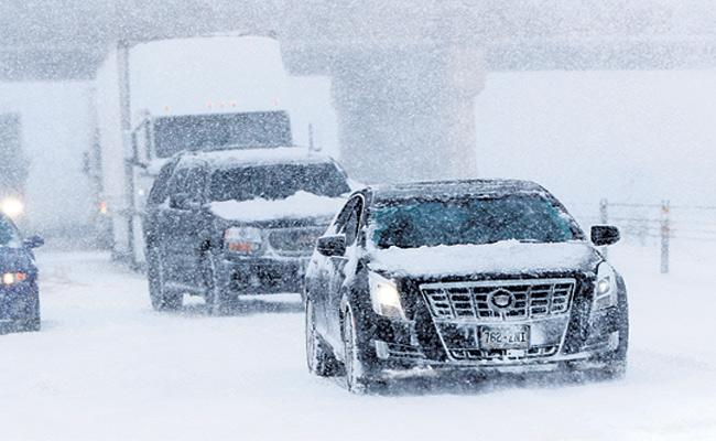 Bomb Cyclone Packed Blizzard Blasts 100 MPH Winds Across Central US - Sakshi