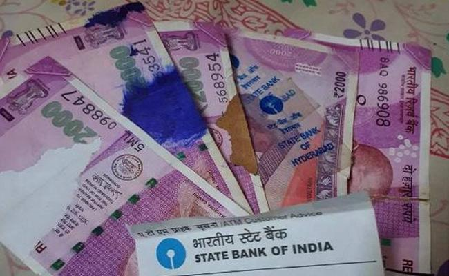 Customer Shocks For Withdrawal Damaged Notes From ATM In Mylavaram - Sakshi