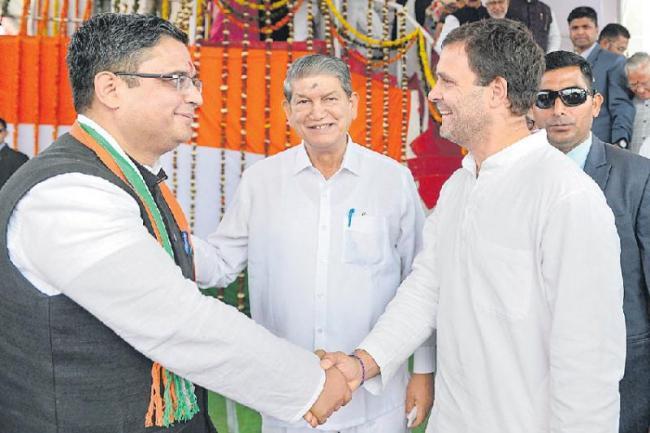 One Modi giving away crores to other Modis - Sakshi
