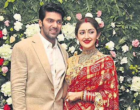 Newly weds Arya and Sayyeshaa pair up for a new movie - Sakshi