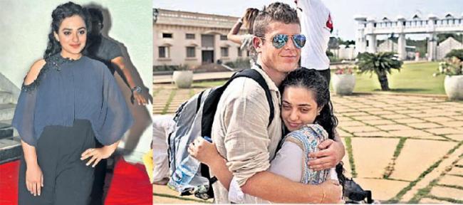 Nithya Menen tight hug to mystery man - Sakshi