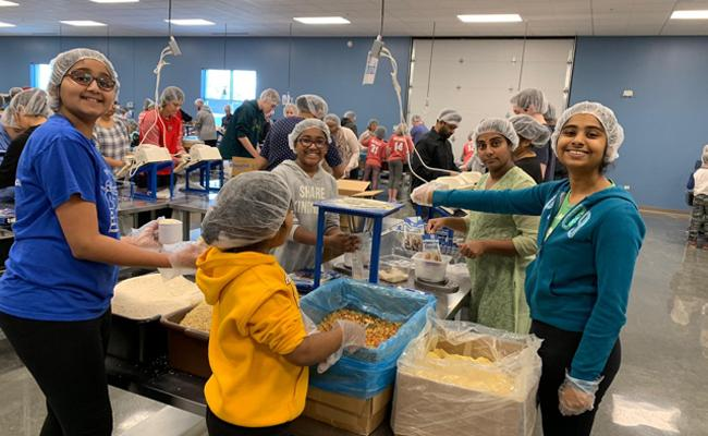 NATS donates food to Feed My Starving Children in Schaumburg - Sakshi