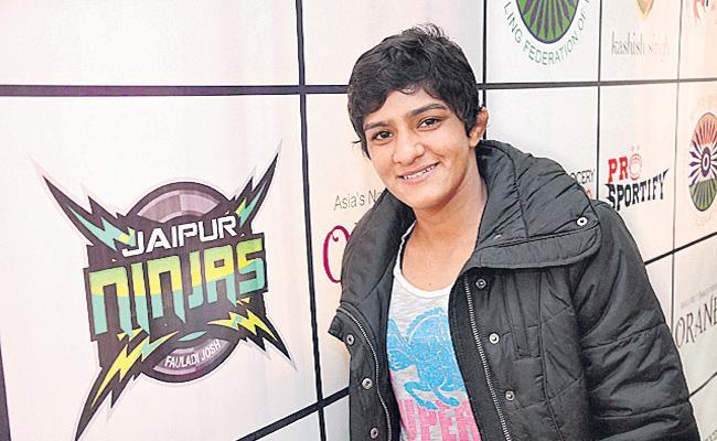 Wrestler Ritu Phogat dropped from TOPS - Sakshi