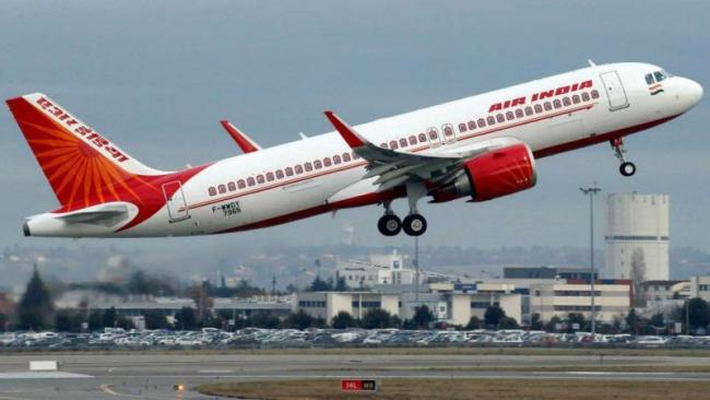 Air India has instructed its pilots to not order special meals - Sakshi