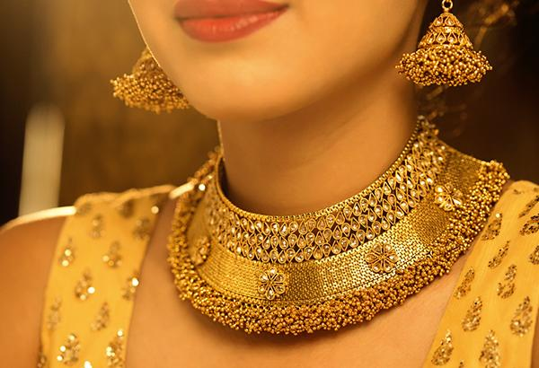 Gold Rate: Gold inches lower on muted spot demand - Sakshi